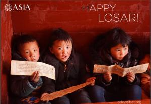 Deseale Feliz Losar a un niño Tibetano